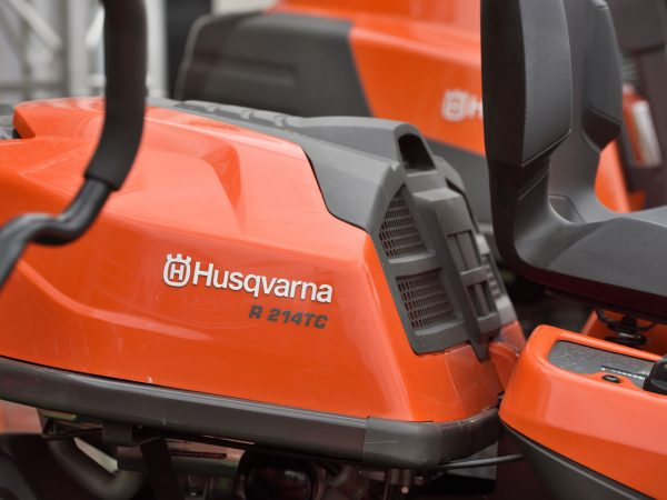 Vilnius, Lithuania – April 25: Husqvarna garden tractor and logo on April 25, 2018 in Vilnius Lithuania. Husqvarna Group is manufacturer of outdoor power products based in Stockholm, Sweden